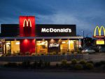 """""""Halifax, Nova Scotia Canada - May 27, 2012: A new style, redesigned McDoanld's MC Cafe location at dusk with illuminated signs in Halifax, Nova Scotia, Canada."""""""